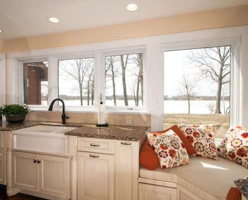 Kitchen design and window seat by Kitchens by Design